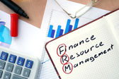 Notepad with words FRM finance resource management  concept. — Stock Photo