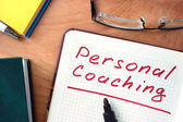 Notepad with Personal coaching   on office wooden table. — Stock Photo