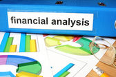 Folder with label financial analysis  and charts. — Stock Photo