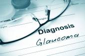 Diagnosis list with Glaucoma and glasses. — Stock Photo