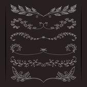 Set of elegant calligraphic foliate borders — Stock Vector