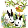 Watercolor rabbits with Easter colorful eggs — Stock Photo #67840397