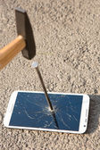 Hammer smashing the screen of a smartphone — Stock Photo