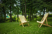 Couple of chairs in park at sunset — Stock Photo