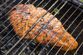 Fish char-grilled over flame — Stock Photo