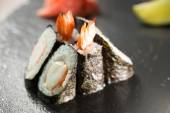 Rolls with shrimp on the black — Foto Stock