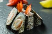 Rolls with shrimp on the black — Stock Photo