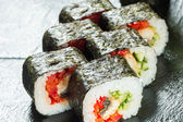 Salmon and caviar rolls served on a plate — Stock Photo