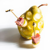 Appetizer. Creative cuisine. Prosciutto with pear on a white background. — Stock Photo