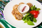 Middle East cuisine. a plate of delicious falafels — Stock Photo