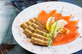 Salmon snack on the white plate, — Stock Photo