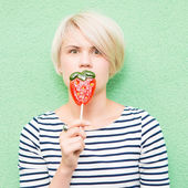Young sexy woman sucking lollipop. — Stock Photo
