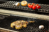 Steak flame broiled on a barbecue — Stock Photo