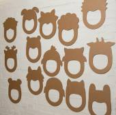 Set of cardboard masks on a white brick wall. — Stock Photo