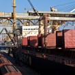 Grain from silos being loaded onto cargo ship on conveyor belt — Stock Photo #63419107