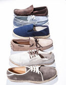 Set of man footwear on a white background — Stock Photo