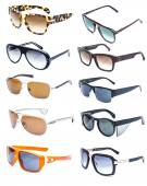 Collection of colorful sunglasses on white background — Stock Photo