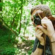 Closeup of young hipster man with digital camera outdoors. — Foto Stock #64427101