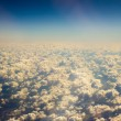 White clouds in blue sky. Aerial view from airplane. — Stockfoto #67375835