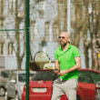 Man play tennis outdoor — Stock Photo #71276477