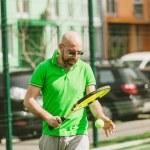 Man play tennis outdoor — Stock Photo #71276727