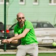 Man play tennis outdoor — Stock Photo #71319149