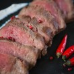 Medium Rare Cooked Beef Roast — Stock Photo #74571453