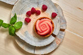 Home made tartlet rose on wooden background. — Stock Photo