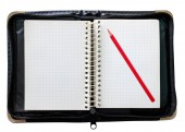 Notepad black and red pencil — Stock Photo