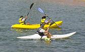 People kayaking at the beach — Stock Photo
