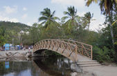 Foot bridge through channel. Les Trois-Îlets, Martinique — Stock Photo