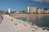Pier, beacon and city beach. Malaga, Spain — ストック写真