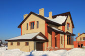 Low construction in country. Two-storeyed brick cottage — Stock Photo