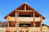 Wooden housing construction, felling from rounded log — Stock Photo