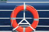 Lifebuoy on deck of cruise liner — Stock Photo