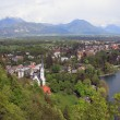 Resort town on coast of Alpine lake. Bled, Slovenia — Stock Photo #74928135