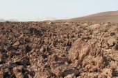 Stiffened lava in Timanfaya park. Lanzarote, Spain — Stock Photo