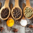Spices. Spice in Wooden spoon. Herbs. Curry, Saffron, turmeric, cinnamon and other on a wooden rustic background. Pepper. Large collection of different spices and herbs. Salt, paprika. — Stock Photo #76899941