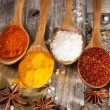 Spices. Spice in Wooden spoon. Herbs. Curry, Saffron, turmeric, cinnamon and other on a wooden rustic background. Pepper. Large collection of different spices and herbs. Salt, paprika. — Stock Photo #76900019