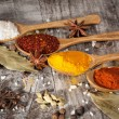 Spices. Spice in Wooden spoon. Herbs. Curry, Saffron, turmeric, cinnamon and other on a wooden rustic background. Pepper. Large collection of different spices and herbs. Salt, paprika. — Stock Photo #76900045
