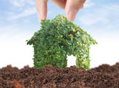 Holding house representing home ownership  — Stock Photo