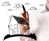 Drawing a growing real estate chart — Stock Photo