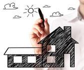 Рисование растущей диаграммы недвижимости — Стоковое фото