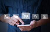 Modern smartphone in hand — Stock Photo
