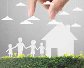 Holding house and family — Stock Photo