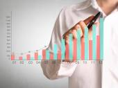 Man drawing a chart show — Stock Photo