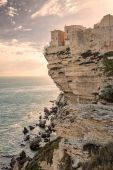 Citadel and houses of Bonifacio above towering white cliffs — Stock Photo