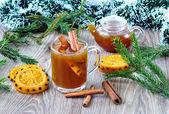 Tea with cinnamon and oranges — Stock Photo