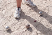 Human's foots in front of petanque balls — Stock Photo