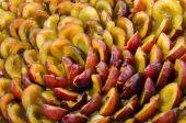 Fresh ripe halved plums — Stock Photo